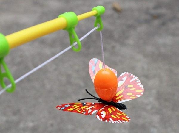 juguete con caña de pesca, juguete de plastico de pesca, caña de plastico de juguete, peses de plastico jugete